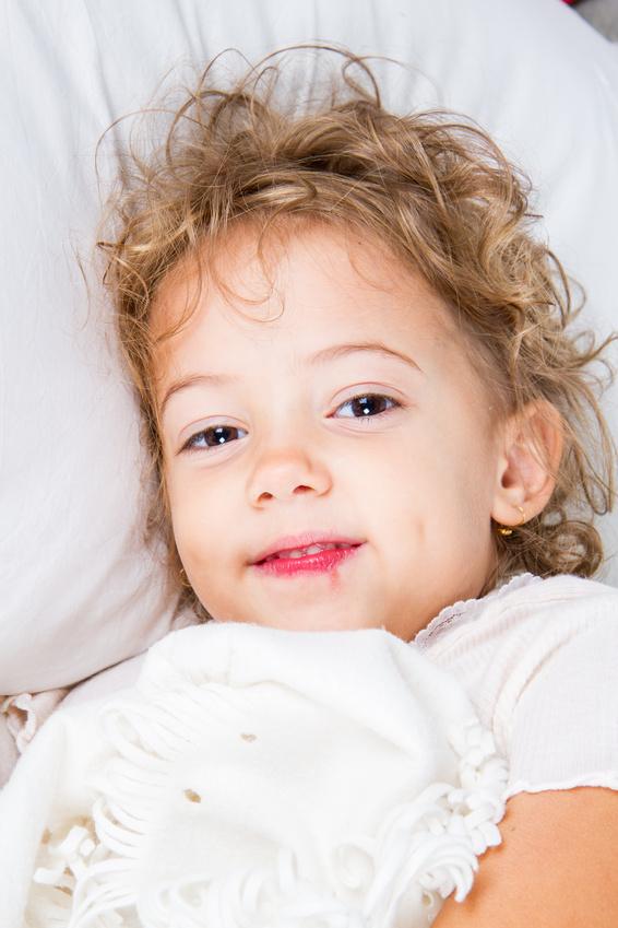 Bambina malata a letto