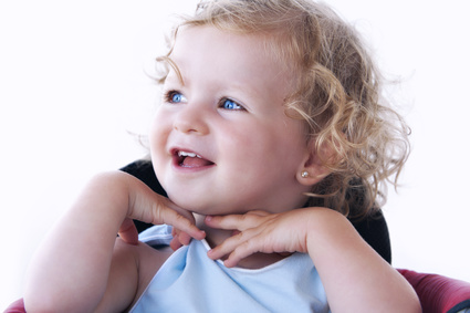 Cute baby with blue eyes and blond hair